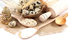 Quail eggs, the ingredients for cooking and kitchen utensils. Stock Photos