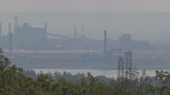 Smog pollution over industrial steel making city Stock Footage