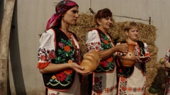 Women in National Ukrainian Costumes Pour Their Milk Jug and Offered Bread, Stock Footage