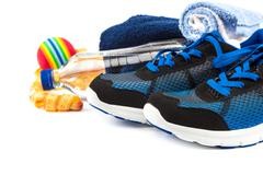 Sport shoes, equipment and measuring tap. Stock Photos