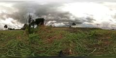 360 VR Rain clouds over farmland nearby street traffic Stock Footage