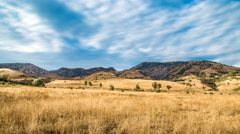 Rapid movement of clouds over the savannah. Stock Footage