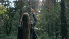Girl throwing arms in Autumn in slow motion, smiling into the camera. Fashion Stock Footage
