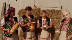 Women of All Ages in the Ukrainian National Costumes, Hayloft, Bread, a Jug of Stock Footage