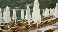 Tanning beds and umbrellas at the beach in Croatia. Adriatic sea. Stock Footage