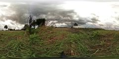 360 VR Rain clouds over farmland nearby street traffic Stock Footage