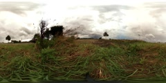 360 VR Rain clouds time-lapse over farmland nearby street traffic Stock Footage