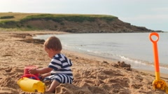 Little boy in the sand at beautiful beach in cape breton Stock Footage