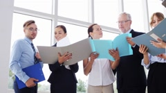 Business team with folders meeting at office 27 Stock Footage
