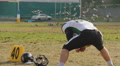 Active lifestyle, player stretching at football pitch, gridiron, sports hobby Footage