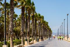 VALENCIA, SPAIN - JULY 23,  2016: People Walking On Valencia Beach Promenade  Stock Photos