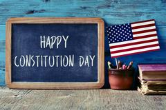 Text happy constitution day and flag of USA Stock Photos