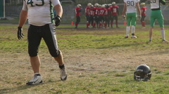 Football players standing in circle on pitch and discussing game strategy Stock Footage