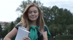 Girl with diary goes to college Stock Footage