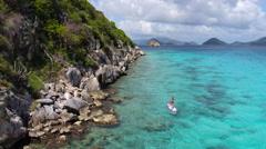 Bikini woman paddle boarding in the Virgin Islands Stock Footage