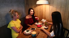 Three Beautiful Female Smile in Cafe, Talk, Tell Secrets, Eat, Drink Coffee. Stock Footage