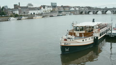 WIDE FIXED Long passenger ship on a lake Meuse, Maastricht, Netherlands. 2K HD Stock Footage