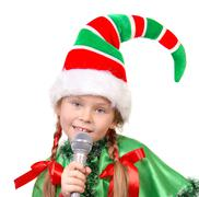 Girl - Santa's elf with a microphone Stock Photos