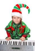 Girl - Santa's elf plays a synthesizer. Kuvituskuvat