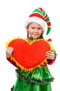 Girl in suit Santa's elf holds heart . Stock Photos