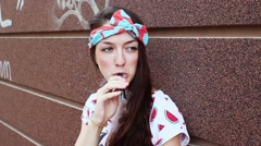 The Girl Smokes Electronic Cigarette. Vaping Stock Footage