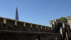 Great Britain England Tower of London peak of The Shard behind fortress wall Stock Footage