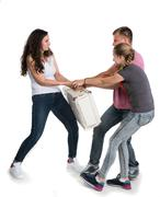 Fighting parents and daughter on a white background.  Divorce Concept Stock Photos