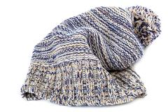 Winter colorful knitted cap on a white Stock Photos