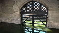 Great Britain England Tower of London famous Traitors Gate in green water Stock Footage