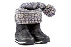 Motley knitted hat or cap and black boots Stock Photos