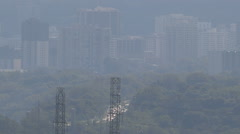 Smog pollution over city during summer heatwave Stock Footage