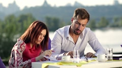 Two business partners signing a contract outdoors Stock Footage