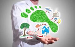 Carbon footprint concept above a human hand Stock Photos