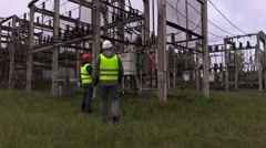 Electrical engineers take inspection the technical condition of the substation Stock Footage