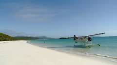 Whitsunday Islands -  Seaplane and Couple Wading on Whitehaven Beach Stock Footage