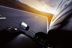 Biker closseup road sunset speed concept Stock Photos