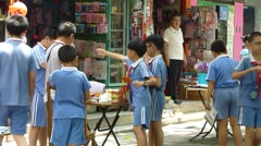 Pupils after school, buy snacks on the roadside Stock Footage