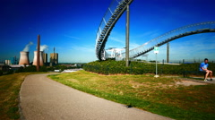 4K Man flying Drone Industry Heritage Trail Tiger and Turtle in Duisburg NRW Stock Footage