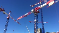 Construction Cranes Working In Urban Zone, Zoom Out Stock Footage