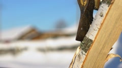 Axe chopping log. Chopping wood in the winter. Splinters of wood Stock Footage
