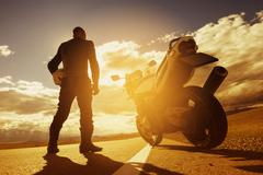 Biker motorcycle road travel concept Stock Photos