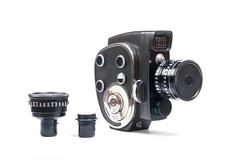 Vintage movie camera and two additional lens isolated on white Stock Photos