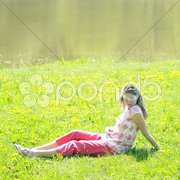 Pregnat woman on meadow Stock Photos