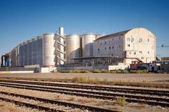 Silos within the commercial port of the city Stock Photos