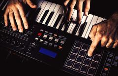 Playing a Midi Keyboard Stock Photos