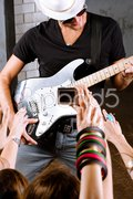 Guitarist playing for is fans Stock Photos