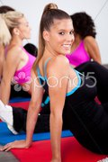 Group of gym people in an aerobics class Stock Photos