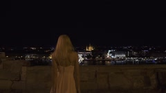 Charming blonde sexy girl standing on the bridge at night blurred lights of Las Stock Footage