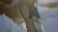 An unknown man chops wood in the winter. Lumberjack chopping wood Stock Footage