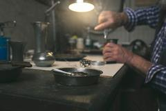 Cigarette on ashtray in workshop Stock Photos